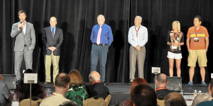 Simon Black on stage with Jim Rickards, Mark Faber, Peter Schiff, Kim Kiyosaki, and Robert Kiyosaki at one of our events.