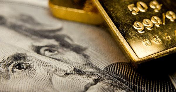 srcset=https://cdn.sovereignman.com/wp-content/uploads/2013/11/Gold-dollars-USD.png